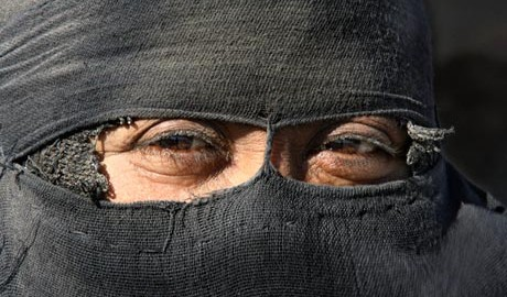 An Iraqi bedouin veiled woman is seen in